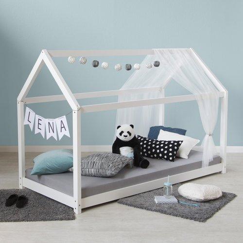 Kuschelecke im Kinderzimmer mit Hausbett